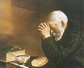 Daily Bread Man Praying At Dinner Table